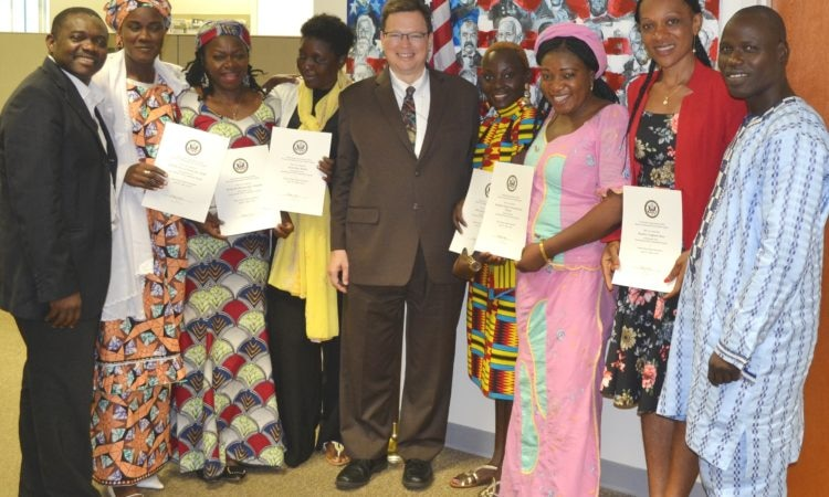 PAO Lee McManis (center) with Cameroonian female journalists and Embassy Staff.